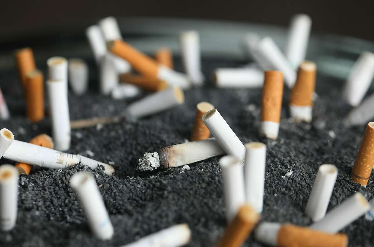 FILE - This March 28, 2019 photo shows cigarette butts in an ashtray in New York. A decade after President Barack Obama signed the Family Smoking Prevention and Tobacco Control Act into law in 2009, health advocates say the Food and Drug Administration has yet to put in place the most sweeping changes envisioned by Congress. (AP Photo/Jenny Kane, File)