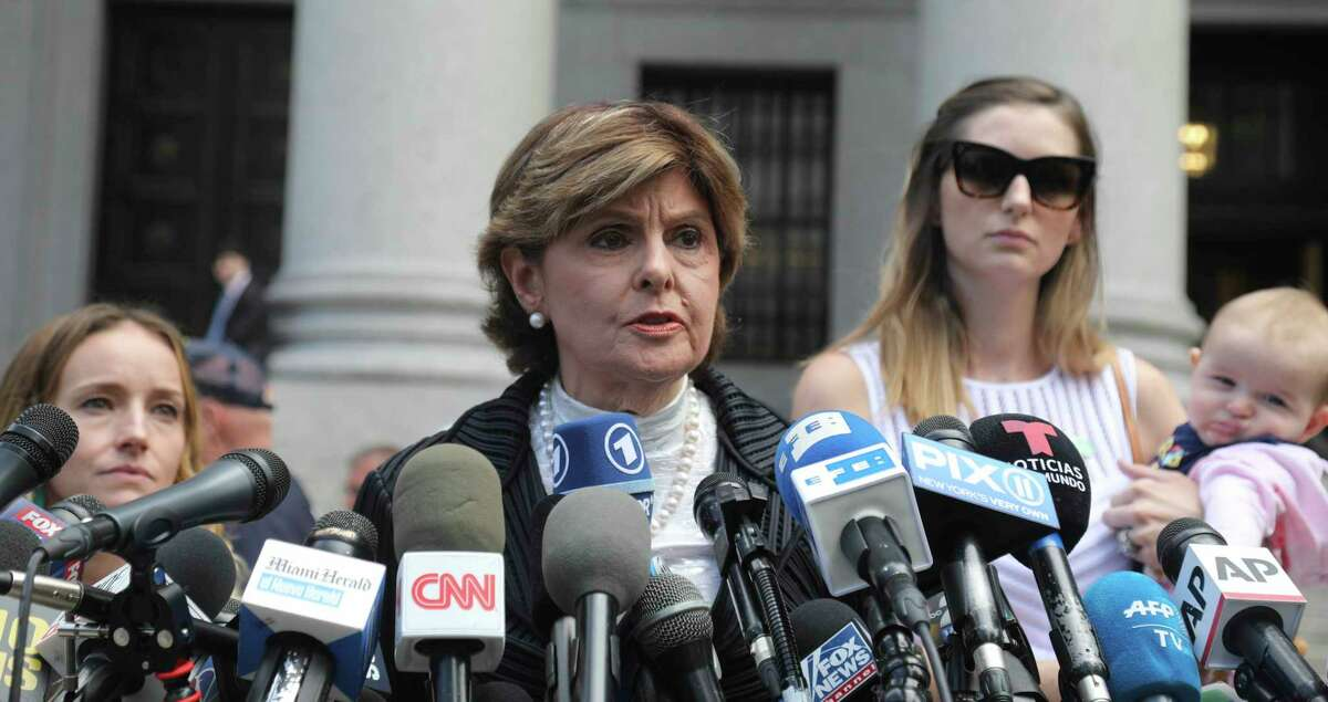 Attorney Gloria Allred, center, flanked by two of her clients, speaks during a news conference after leaving a Manhattan court where sexual victims, on invitation of a judge, addressed a hearing after the accused Jeffrey Epstein killed himself before facing sex trafficking charges, Tuesday Aug. 27, 2019, in New York. (AP Photo/Bebeto Matthews)