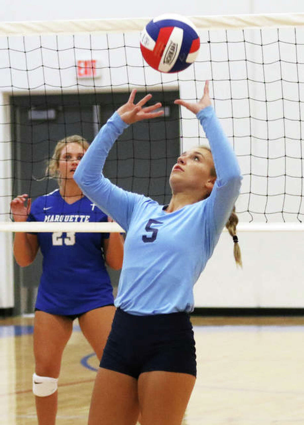 Jersey junior Clare Breden, one of two returning setters in the Panthers 6-2 offense, sets during a match against Marquette on Monday at Roxana.