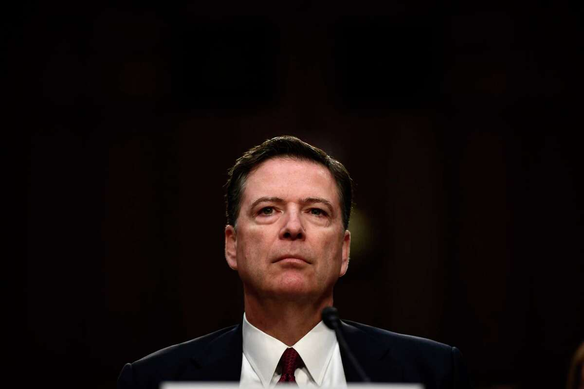 (FILES) In this file photo taken on June 8, 2017 Former FBI Director James Comey arrives to testify during a US Senate Select Committee on Intelligence hearing on Capitol Hill in Washington,DC. - Former FBI director James Comey violated the rules of the FBI by keeping records of his exchanges with Donald Trump but did not transmit confidential information to the press, according to an official report released on August 29, 2019. (Photo by Brendan Smialowski / AFP)BRENDAN SMIALOWSKI/AFP/Getty Images