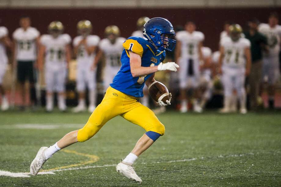 Midland's Bryce Albrecht carries the ball down the field during the Chemics' game against Traverse City West Thursday, Aug. 29, 2019 at Midland Community Stadium. (Katy Kildee/kkildee@mdn.net) Photo: (Katy Kildee/kkildee@mdn.net)