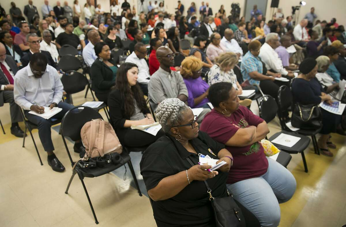 Citizens listen to Mayor Sylvester Turner during a town hall meeting about Hurricane Harvey recovery on Thursday, Aug. 29, 2019, in the Fifth Ward.