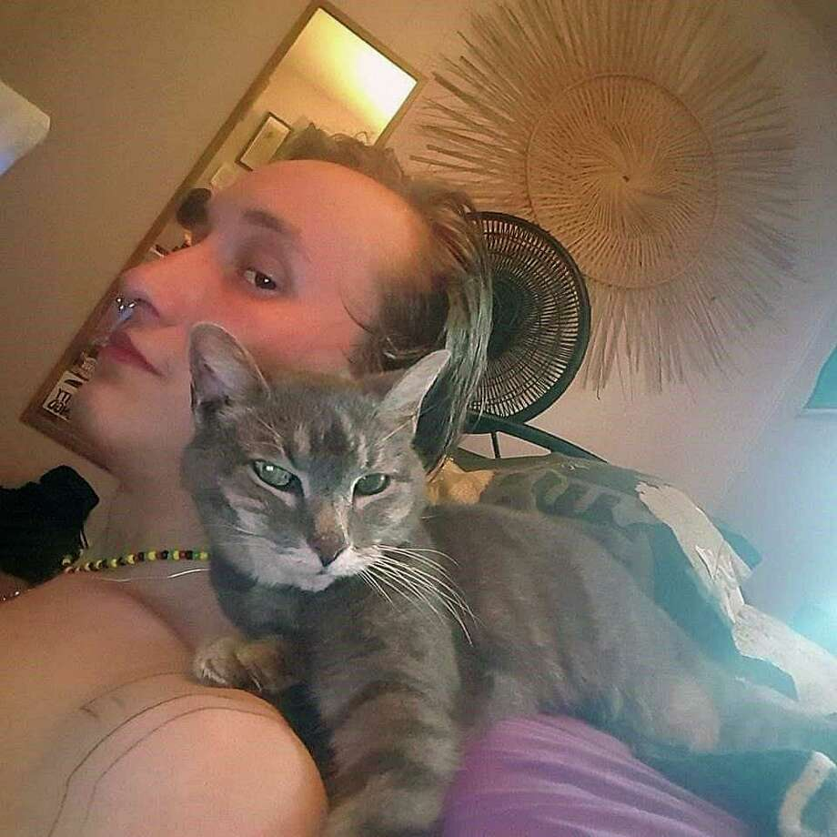 Richie Allen with the family cat, Destiny, a few months before she died. Photo: Contributed Photo