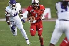 Lamar senior quarterback Jordan Hoy runs during the first half of the Cardinals season-opener against Bethel University at Provost Umphrey Stadium on Thursday night. Photo by Ryan Welch/The Enterprise.