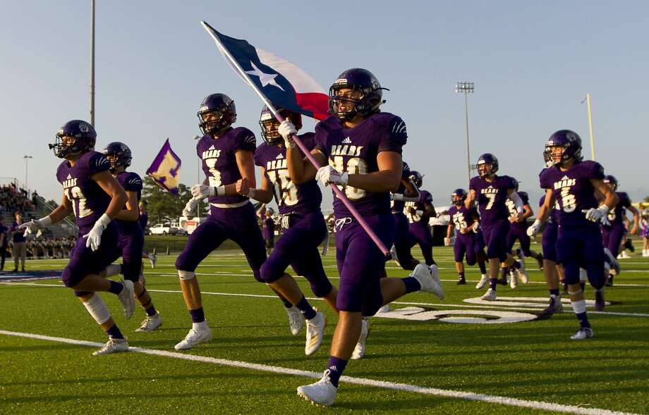 Montgomery takes the field before a non-district high school football game at Montgomery ISD Stadium, Thursday, Aug. 29, 2019, in Montgomery. Photo: Jason Fochtman, Staff Photographer