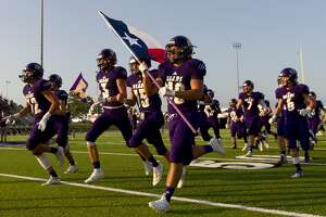 Montgomery takes the field before a non-district high school football game at Montgomery ISD Stadium, Thursday, Aug. 29, 2019, in Montgomery.