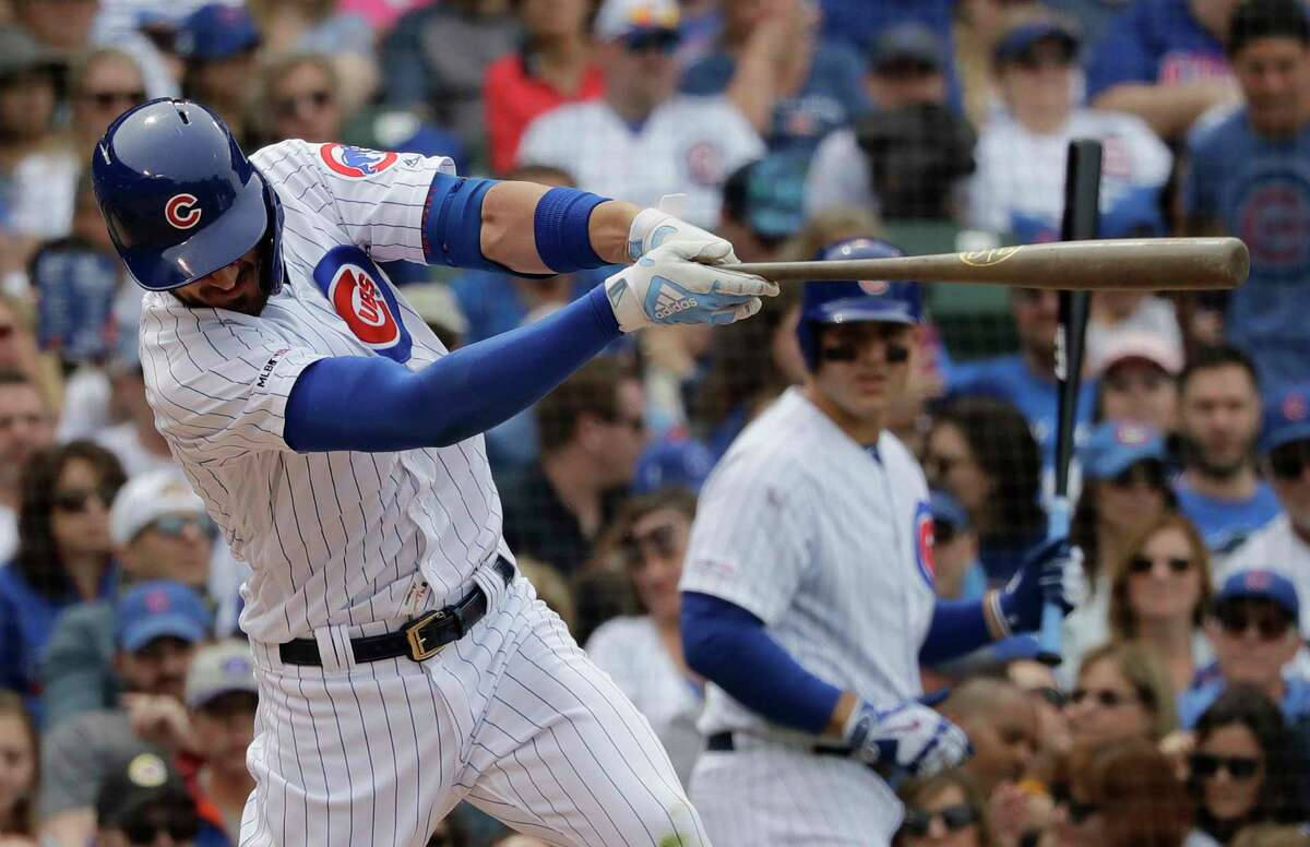 FILE - In this June 21, 2019, file photo, Chicago Cubs' Kris Bryant hits a double during the fifth inning of the team's baseball game against the New York Mets in Chicago. Pete Alonso made a friendly offer toBryant in June, one that gave the Cubs star an appreciation for the Mets sluggera€™s big heart, but even more so for the breakout rookiea€™s big muscles. During a series between the Mets and Cubs at Wrigley Field, Alonso gave one of his specially made 34-inch, 32-ounce birch bats to Bryant. The 2016 NL MVP used it for about a week, and even hit a long homer with it against Atlantaa€™s Dallas Keuchel. In the end, though, the 6-foot-5 Bryant realized he didna€™t have the might necessary to power Alonsoa€™s weapon of choice. a€œThe bat he swings is so big, ita€™s so heavy,a€ Bryant said. a€œHea€™s an animal, man.a€ (AP Photo/Nam Y. Huh, File)