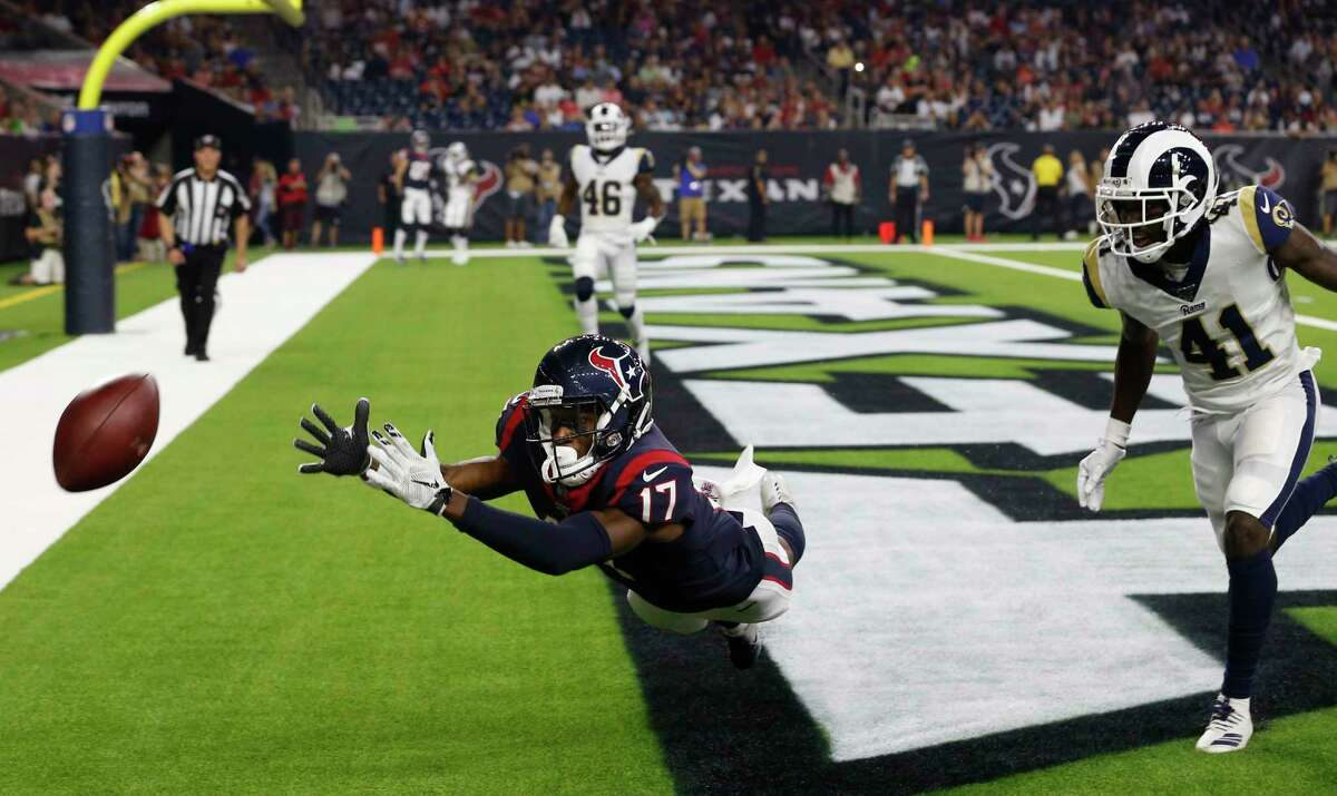 Houston Texans wide receiver Vyncint Smith (17) can't come down with a reception in the end zone sigh Los Angeles Rams defensive back David Long (41) defending during an NFL preseason football game at NRG Stadium on Thursday, Aug. 29, 2019, in Houston.
