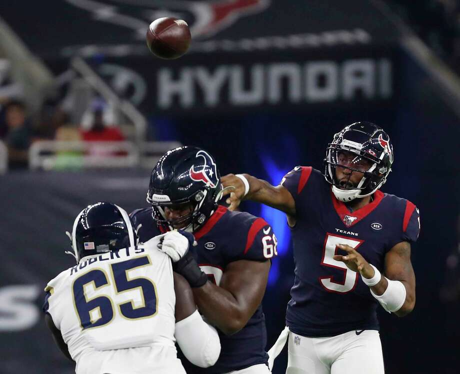 Houston Texans quarterback Joe Webb (5) throws a pass over Los Angeles Rams defensive tackle Boogie Roberts (65) during an NFL preseason football game at NRG Stadium on Thursday, Aug. 29, 2019, in Houston. Photo: Brett Coomer, Staff Photographer / © 2019 Houston Chronicle