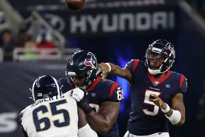 Houston Texans quarterback Joe Webb (5) throws a pass over Los Angeles Rams defensive tackle Boogie Roberts (65) during an NFL preseason football game at NRG Stadium on Thursday, Aug. 29, 2019, in Houston.