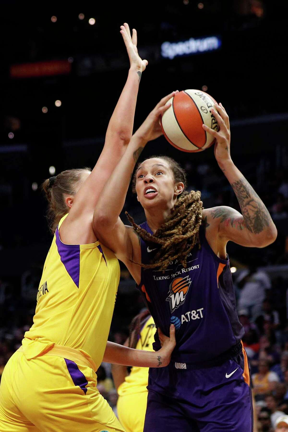 LOS ANGELES, CALIFORNIA - AUGUST 08: Center Brittney Griner #42 of the Phoenix Mercury looks for a shot defended by center Maria Vadeeva #7 of the Los Angeles Sparks at Staples Center on August 08, 2019 in Los Angeles, California. NOTE TO USER: User expressly acknowledges and agrees that, by downloading and or using this photograph, User is consenting to the terms and conditions of the Getty Images License Agreement. (Photo by Meg Oliphant/Getty Images)