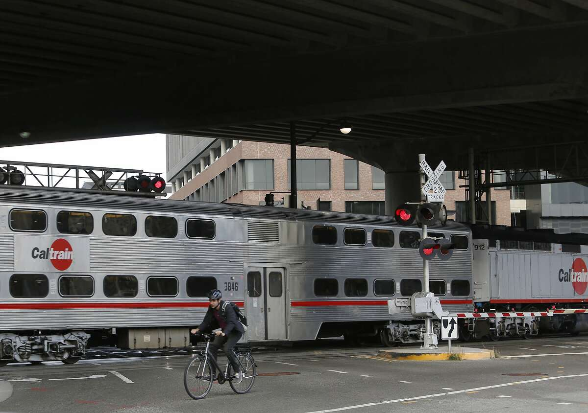 A biker rides by the 16th Street Caltrain tracks on Thursday, July 26, 2018 in San Francisco, Calif.