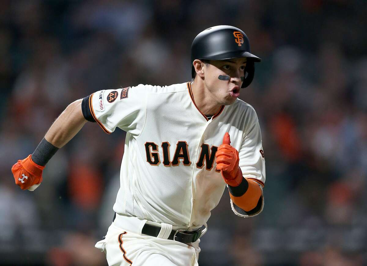 Mauricio Dubon #19 of the San Francisco Giants runs to first base for a single for his first Major League hit in the fifth inning of their game against the San Diego Padres at Oracle Park on August 29, 2019 in San Francisco, California.