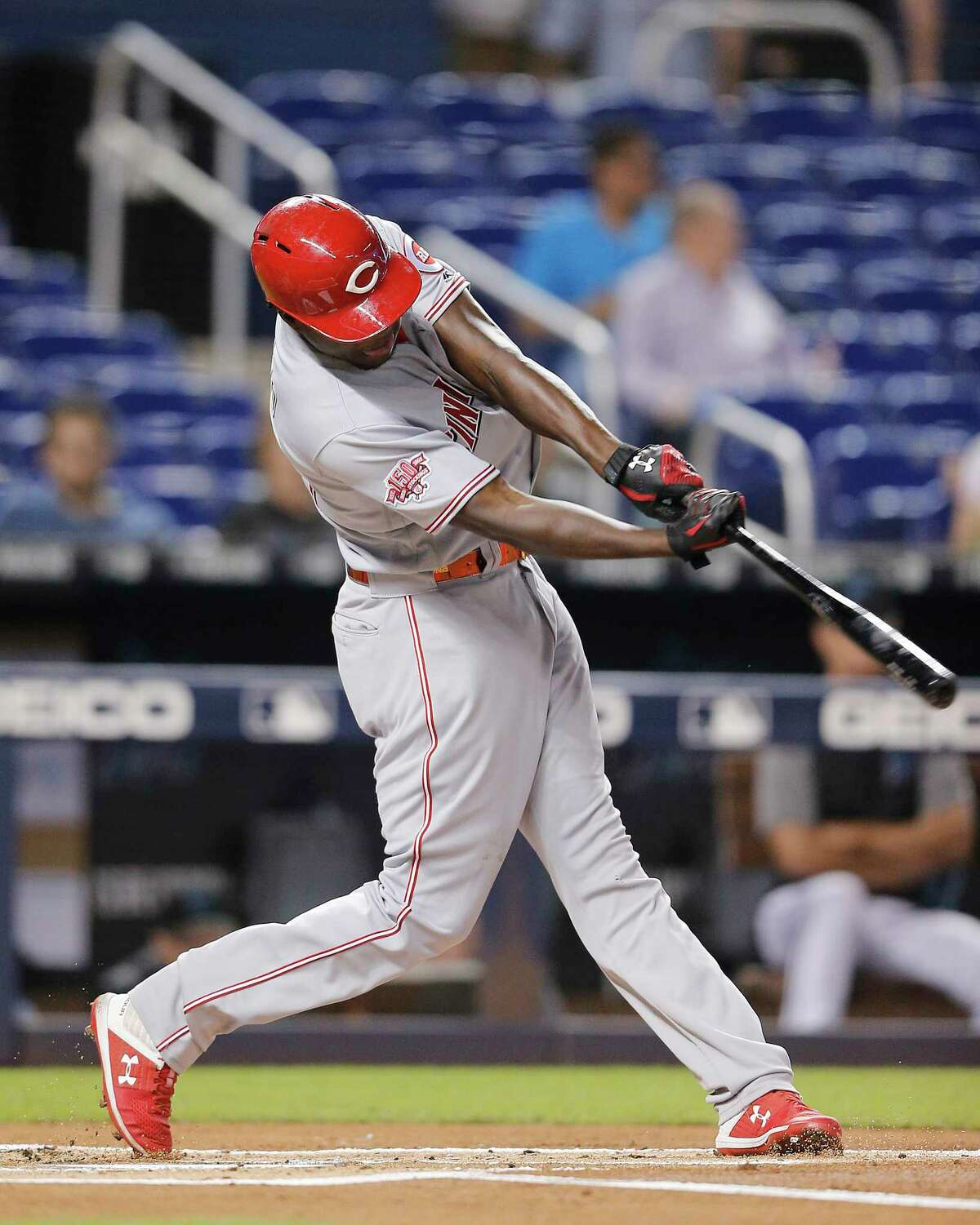 MIAMI, FLORIDA - AUGUST 29: Aristides Aquino #44 of the Cincinnati Reds hits a two-run home run against the Miami Marlins during the first inning at Marlins Park on August 29, 2019 in Miami, Florida. (Photo by Michael Reaves/Getty Images)