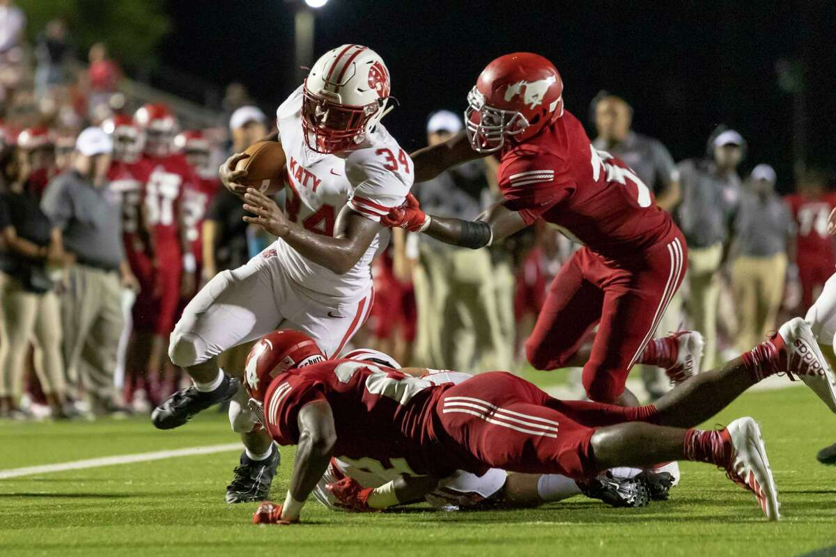 PHOTOS: More from Thursday night's big game Katy receiver Jordan Patrick (13) catches a pass and runs for a touchdown in the second half of a high school football game at Galena Park ISD Stadium on Thursday, Aug 29, 2019, in Houston.
