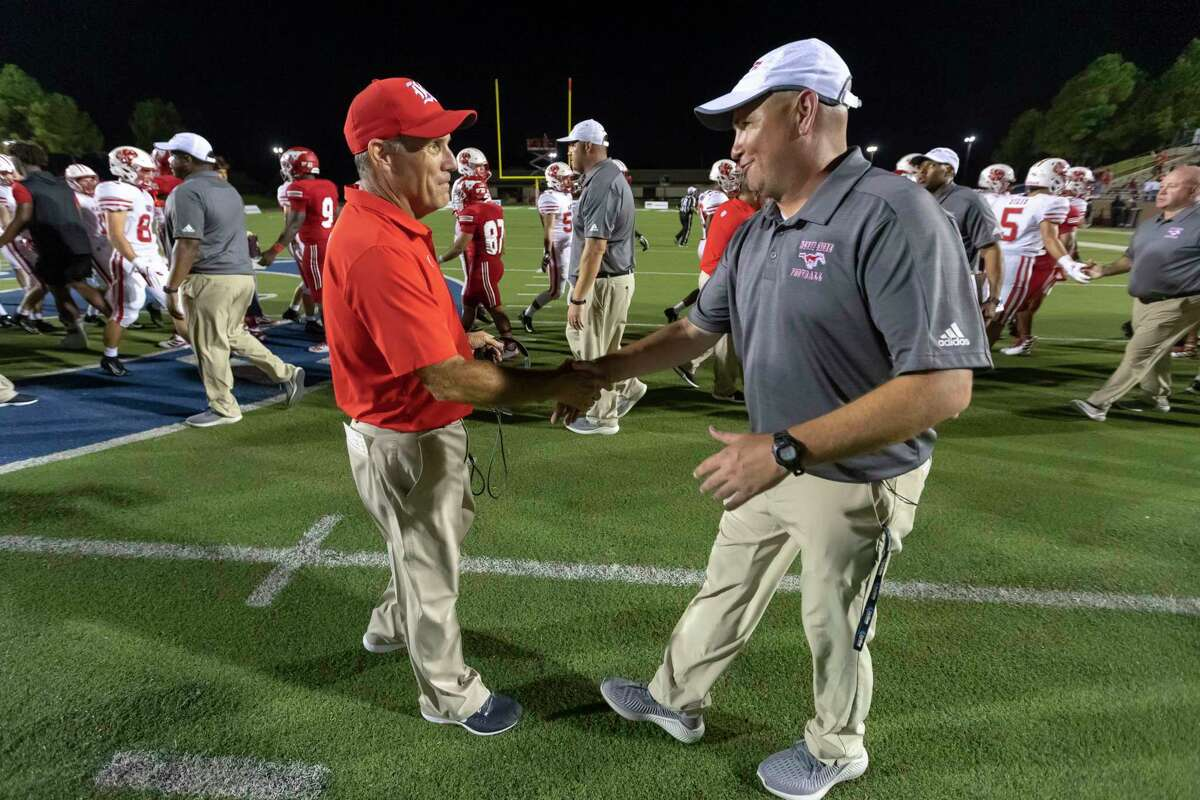 Katy head coach Gary Joseph (left) and North Shore head coach Jon Kay (right) meet to shake hands after Katy defeated North Shore 24-21 in a high school football game at Galena Park ISD Stadium on Thursday, Aug 29, 2019, in Houston.