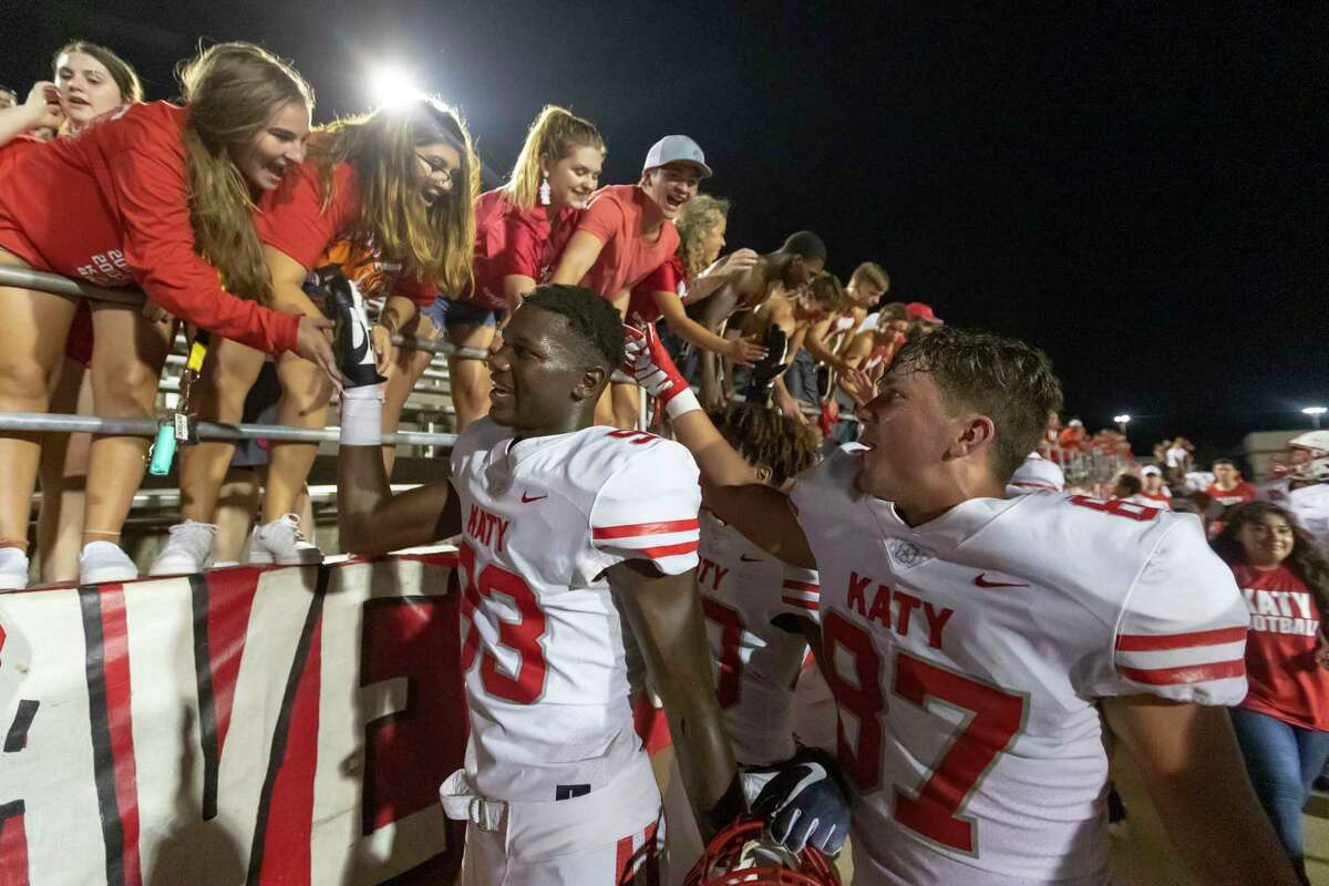 Katy defensive lineman Malik Sylia and tight end Samuel Dunn are congratulated by the Katy student section after defeating North Shore 24-21 in a high school football game at Galena Park ISD Stadium on Thursday, Aug 29, 2019, in Houston.