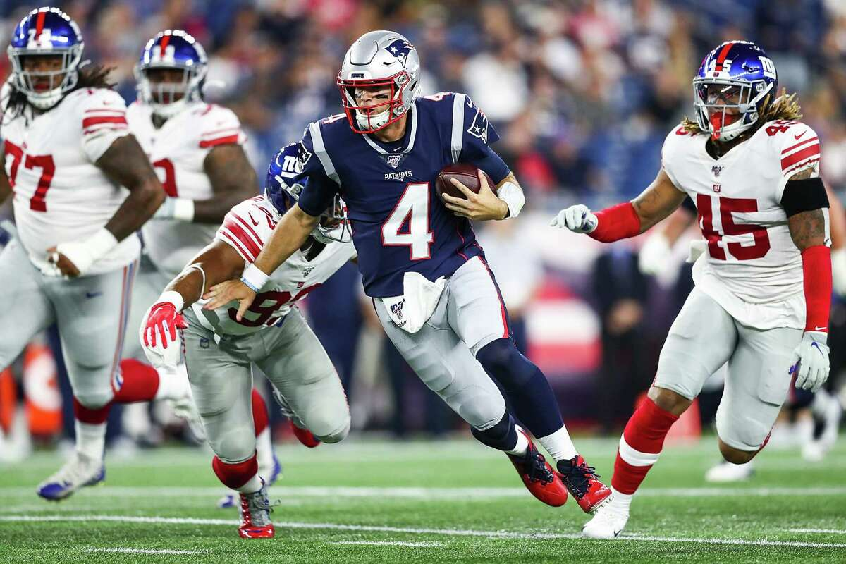FOXBOROUGH, MA - AUGUST 29: Jarrett Stidham #4 of the New England Patriots runs with the ball during a preseason game against the New York Giants at Gillette Stadium on August 29, 2019 in Foxborough, Massachusetts. (Photo by Adam Glanzman/Getty Images)
