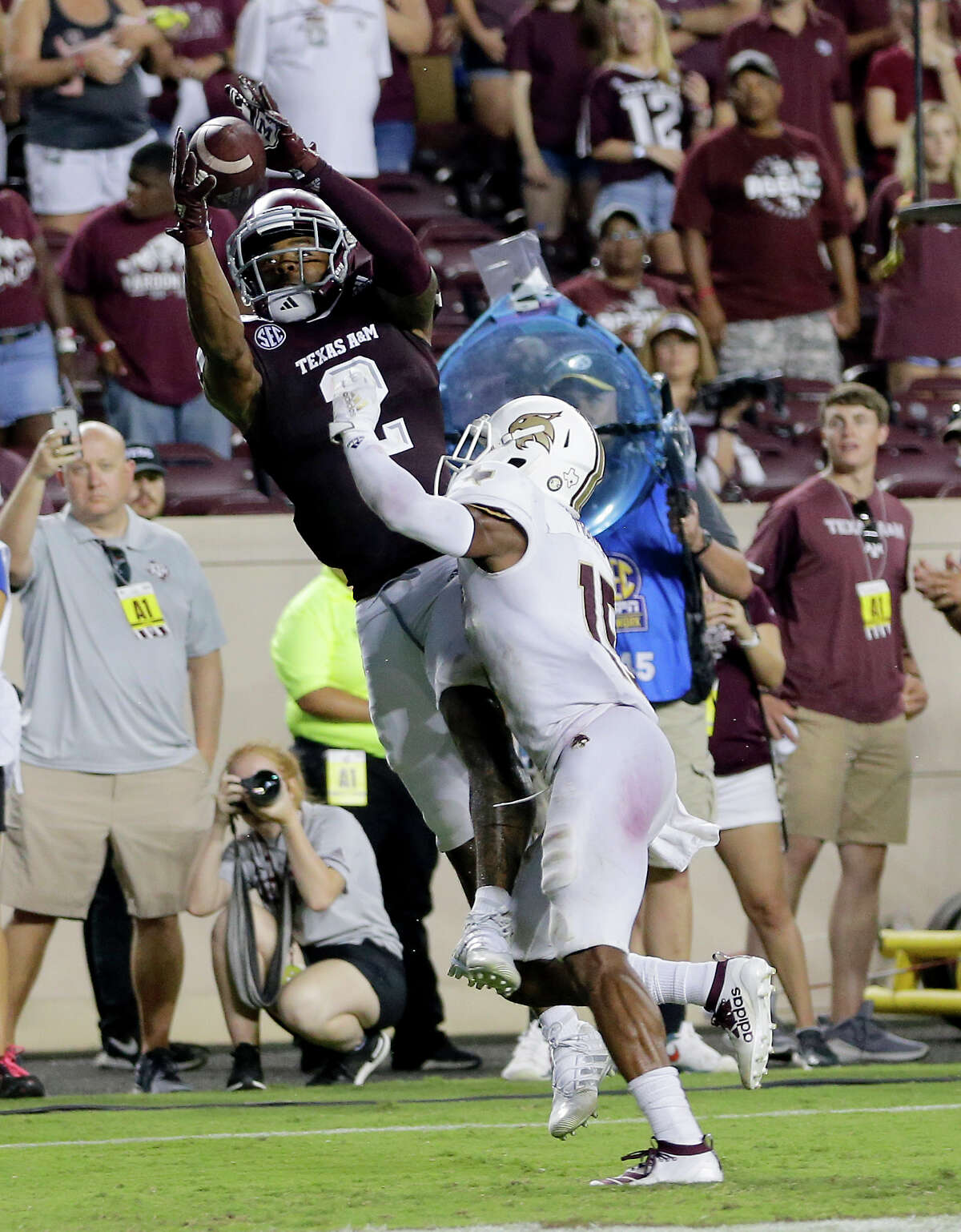 Texas A&M wide receiver Jhamon Ausbon (2) catches a pass for a touchdown against Texas State defensive back Jarron Morris (15) during the second half of an NCAA college football game Thursday, Aug. 29, 2019, in College Station, Texas. (AP Photo/Sam Craft)