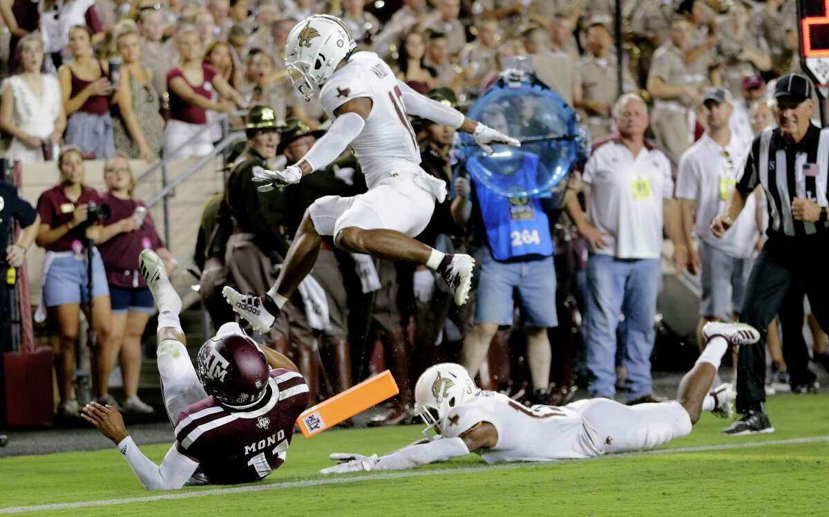 Texas A&M quarterback Kellen Mond (11) scores a touchdown as Texas State defenders follow him into the end zone during the first half of an NCAA college football game, Thursday, Aug. 29, 2019, in College Station, Texas. (AP Photo/Sam Craft)