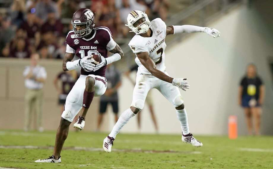 Texas A&M defensive back Myles Jones (10) intercepts a pass intended for Texas State wide receiver Jeremiah Haydel (3) during the first half of an NCAA college football game Thursday, Aug. 29, 2019, in College Station, Texas. (AP Photo/Sam Craft) Photo: Sam Craft, Associated Press / AP