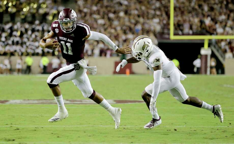 Texas A&M quarterback Kellen Mond (11) fights off Texas State defensive back Jarron Morris (15) while rushing for a touchdown during the first half of an NCAA college football game Thursday, Aug. 29, 2019, in College Station, Texas. (AP Photo/Sam Craft) Photo: Sam Craft, Associated Press / AP