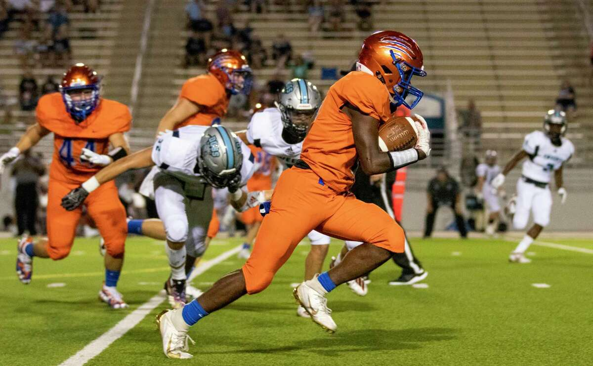 Grand Oaks running back Micah Cooper (8) runs the ball during a non-district game Thursday, August 29, 2019 at Woodforest Bank Stadium in Shenandoah.