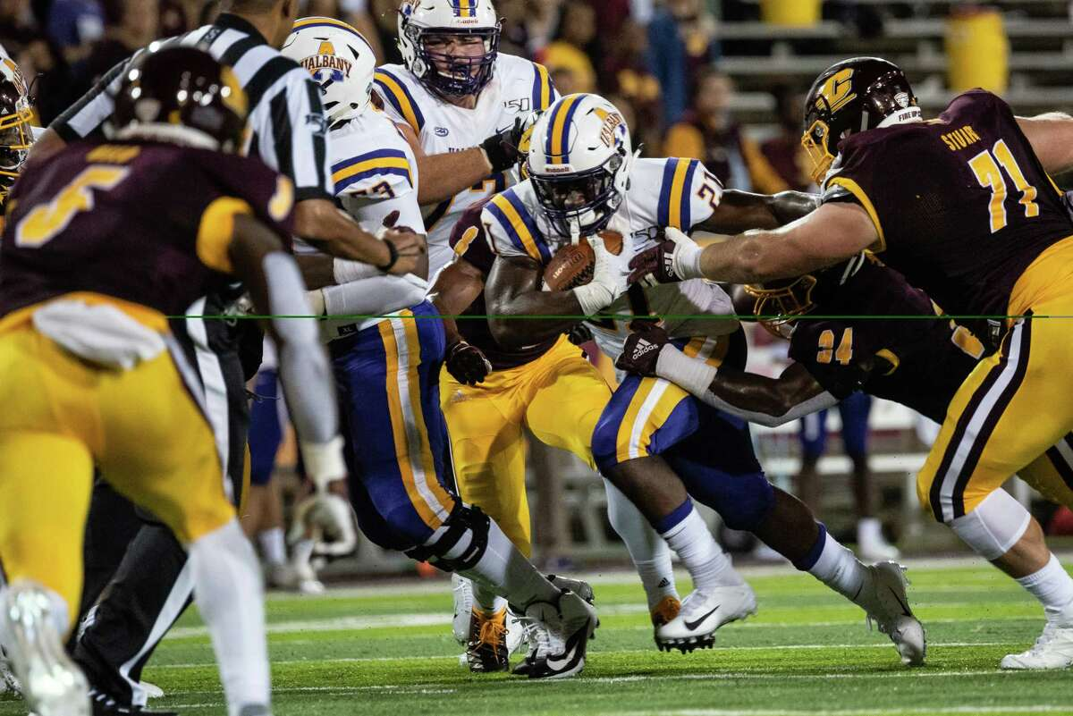 Karl Mofor of UAlbany carries the ball against Central Michigan in their season opener on Thursday, Aug. 29, 2019. (Isaac Ritchey / Special to the Times Union)