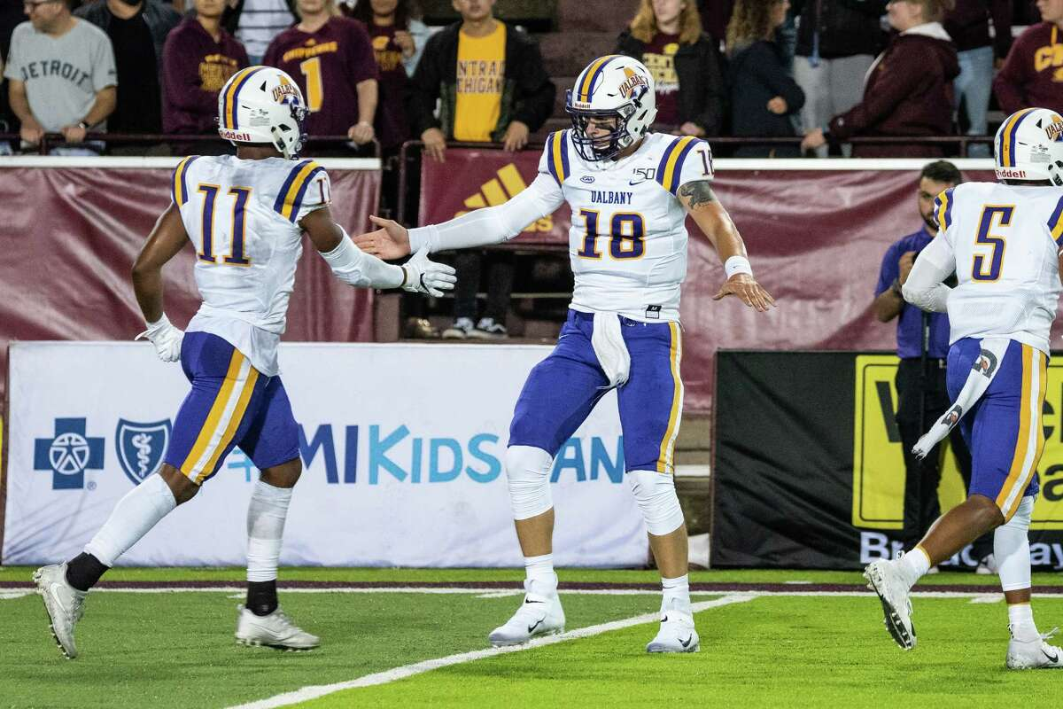 UAlbany quarterback Jeff Undercuffler, right, celebrates with wide receiver Jerah Reeves after scoring a touchdown against Central Michigan on Thursday, Aug. 29, 2019, at Kelly Shorts Stadium. (Isaac Ritchey / Special to the Times Union)