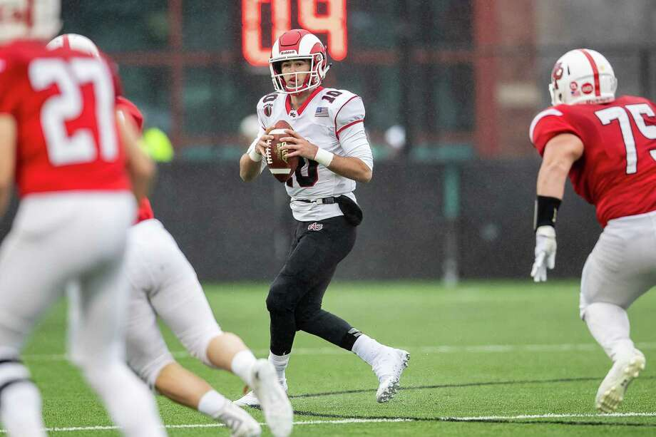 New Canaan quarterback Drew Pyne (10) looks for an open receiver during a the Class LL semifinals against Fairfield Prep last December. Photo: John McCreary / For Hearst Connecticut Media / Connecticut Post Freelance