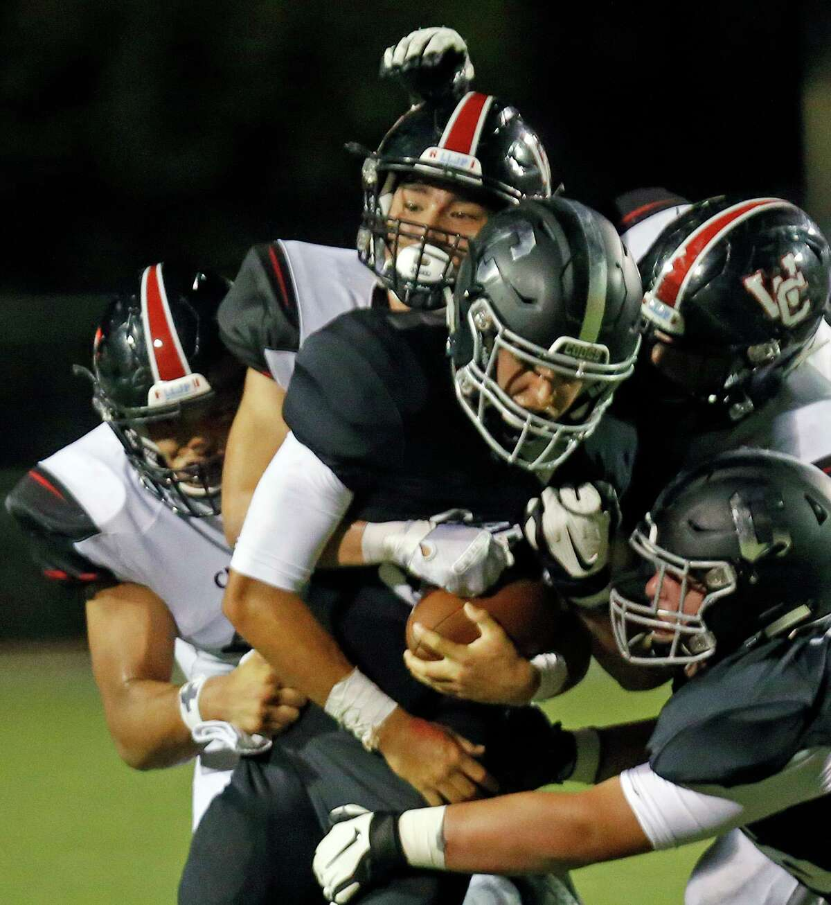 Clark quaterback David Santos is swarmed by Churchill defenders in second half action. Churchill defeated Clark 19-0 on Thursday, August 30, 2019 at Farris Stadium.