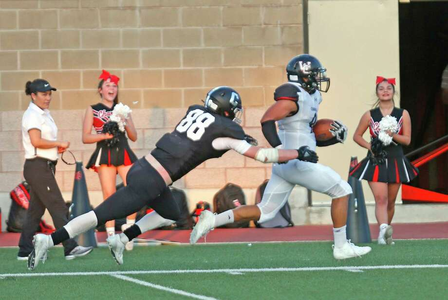 Churchill running back Michael Doty is finally brought down by Clark Defensive lineman Cameryn Bell after a 55 yard run in first half action set up the only touchdown. HS football game between Clark & Churchill on Thursday, August 30, 2019 at Farris Stadium. Photo: Ronald Cortes/Contributor / 2019 Ronald Cortes