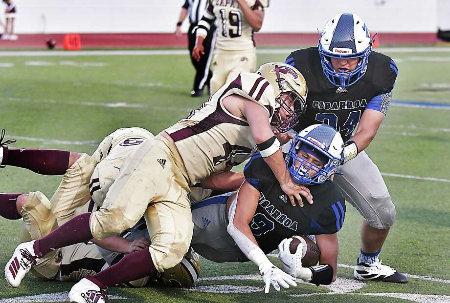 Wide receiver Alex Guzman is tackled by Zapata Hawks defenders as he carries the ball for the Cigarroa Toros Thursday, August 29, 2019 at Shirley Field. Photo: Cuate Santos / Laredo Morning Times / Laredo Morning Times