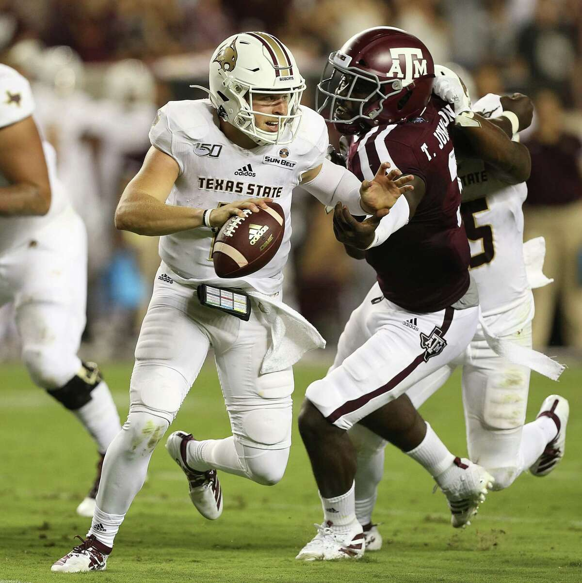 COLLEGE STATION, TEXAS - AUGUST 29: Tyler Vitt #11 of the Texas State Bobcats scrambles out of the pocket as Tyree Johnson #3 of the Texas A&M Aggies pursues in the first half at Kyle Field on August 29, 2019 in College Station, Texas. (Photo by Bob Levey/Getty Images)