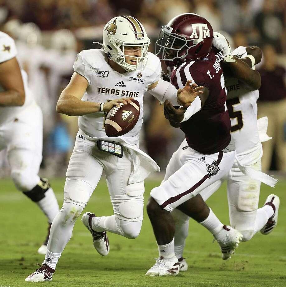 COLLEGE STATION, TEXAS - AUGUST 29: Tyler Vitt #11 of the Texas State Bobcats scrambles out of the pocket as Tyree Johnson #3 of the Texas A&M Aggies pursues in the first half at Kyle Field on August 29, 2019 in College Station, Texas. (Photo by Bob Levey/Getty Images) Photo: Bob Levey, Stringer / Getty Images / 2019 Getty Images