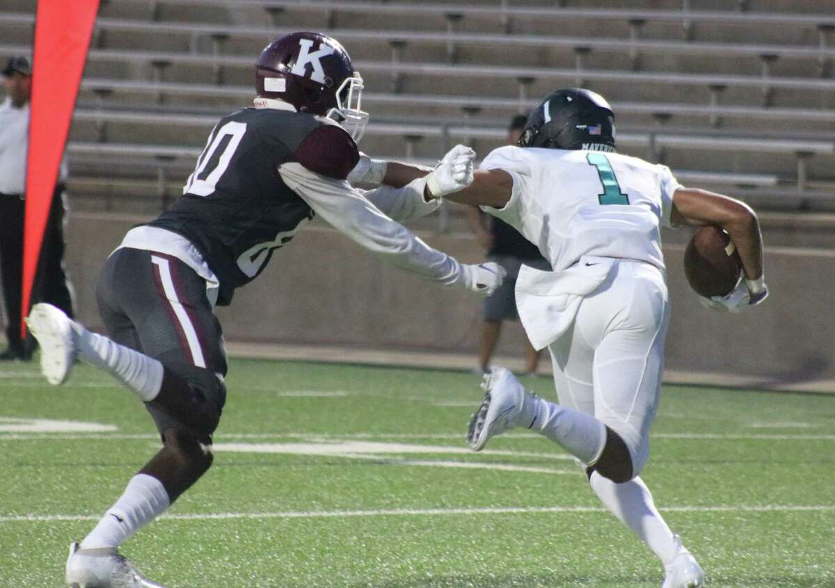 Memorial High School's Jordan See comes up with the team's first interception of the new season with a theft near the goal line Thursday night. Kempner tried a little floater over the top and See used an over-the-shoulder catch to haul it in.