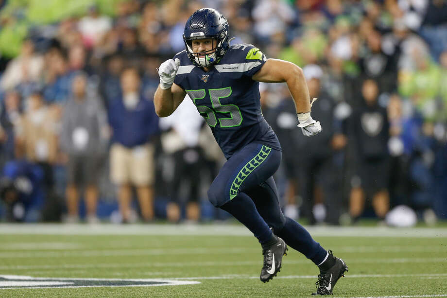 """DID BEN BURR-KIRVEN EARN A PLACE ON SEATTLE'S 53?  The fifth-round pick out of Washington came up big on a Raiders' 4th-and-1 on the 1-yard line in the opening quarter, blitzing Oakland quarterback Mike Glennon for a monster sack.  It was the biggest highlight of a night of highlights for Burr-Kirven. He was the star of the Seahawks' defense, posting 12 tackles (including two for loss), a pass defensed and the aforementioned sack.  BBK, the 2018 FBS leader in tackles, missed a lot of valuable reps in the spring and early in training camp with a hernia injury, placing him behind the eight ball from the get go. But the ex-Husky standout's high activity on both defense and special teams has placed him right in the thick of the battle in a competitive linebacker group.  """"I hope I just showed them that I'm the kind of player they want to keep around,"""" Burr-Kirven said. """"I hope my effort shows up on tape. That's one of the biggest things I take pride in. Obviously, I've made mistakes here and there, but hopefully they'll see I played my ass off every play. This really means something to me. I want to be here. I don't want to go anywhere else.""""  Burr-Kirven, along with fellow rookie linebacker Cody Barton, received rave reviews about their football IQ during the spring. Head coach Pete Carroll had mentioned that the two picked up the defense as fast as any linebackers he's ever had in Seattle.      Photo: Otto Greule Jr./Getty Images"""