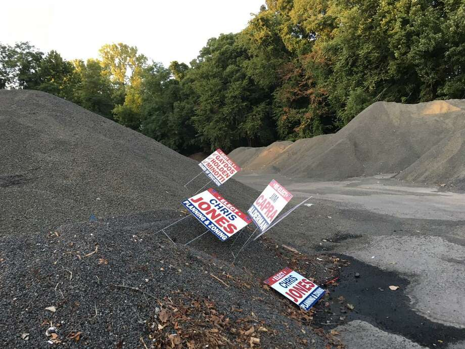 Jim Capra, a member of Here for Shelton and running for Board of Aldermen's fourth ward, claims that campaign signs for members of his group were stolen, with some dumped at the Nike site. Photo: Contributed Photo / Connecticut Post