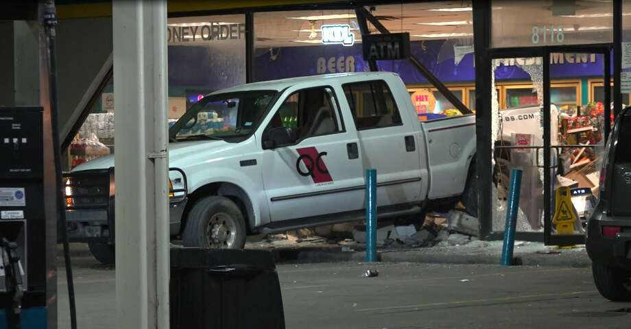 Houston police are searching for several suspects they said purposefully crashed into a south Houston service station to steal an ATM but fled when the clerk began shooting at them. Photo: OnScene.TV