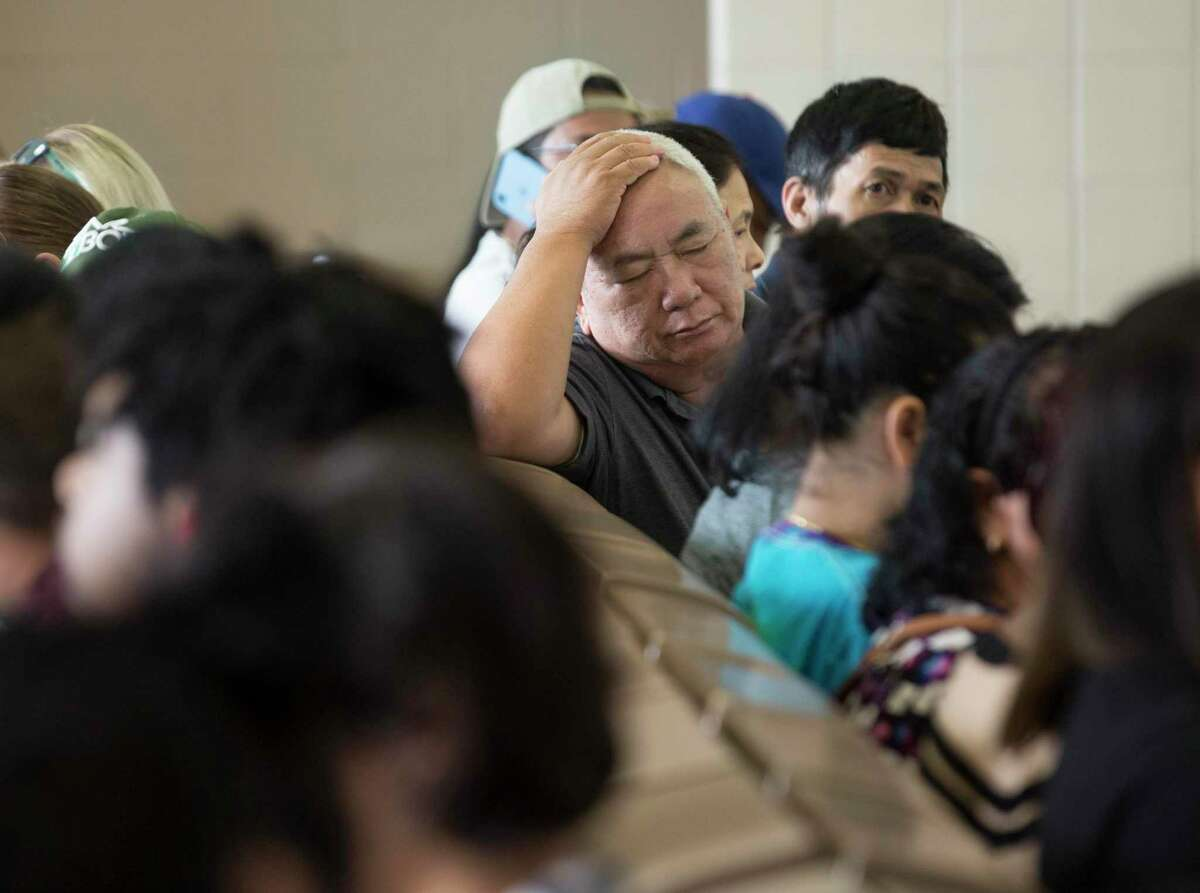 People waiting to be called in the waiting area of a Texas Department of Public Safety Driver License Mega Center at South Gessner Road on Friday, Aug. 23, 2019, in Houston.
