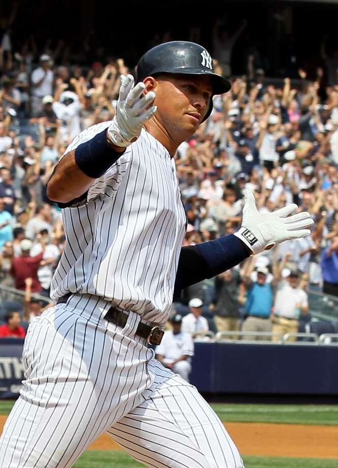 NEW YORK - AUGUST 04:  Alex Rodriguez #13 of the New York Yankees runs the bases after hitting his 600th career home run in the first inning against Shaun Marcum #28 (not pictured) of the Toronto Blue Jays on August 4, 2010 at Yankee Stadium in the Bronx borough of New York City.  (Photo by Jim McIsaac/Getty Images) *** Local Caption *** Alex Rodriguez Photo: Jim McIsaac, Getty Images / 2010 Getty Images