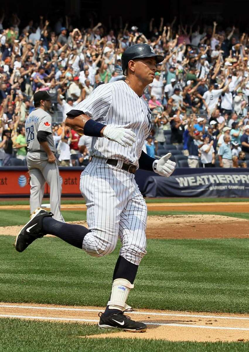 NEW YORK - AUGUST 04: Alex Rodriguez #13 of the New York Yankees runs the bases after hitting his 600th career home run in the first inning against Shaun Marcum #28 of the Toronto Blue Jays on August 4, 2010 at Yankee Stadium in the Bronx borough of New York City. (Photo by Jim McIsaac/Getty Images) *** Local Caption *** Alex Rodriguez