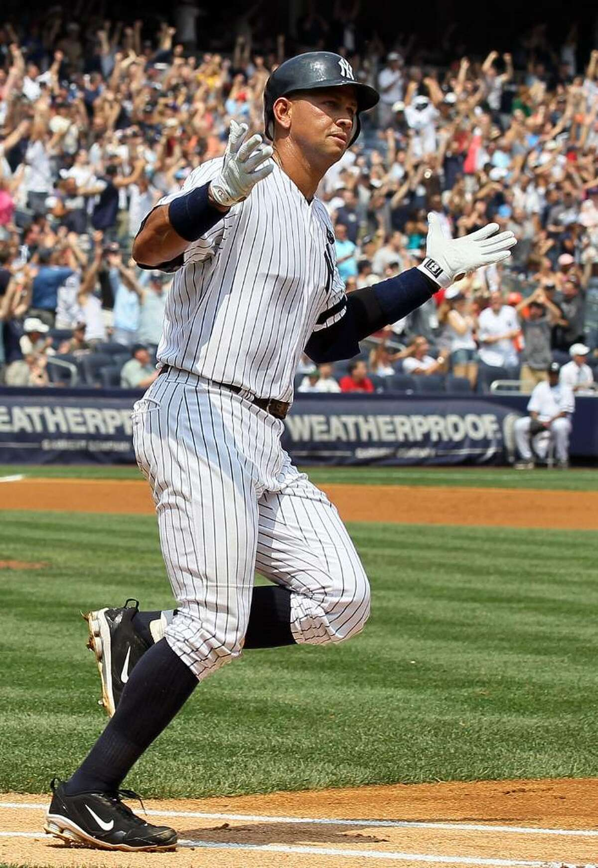 NEW YORK - AUGUST 04: Alex Rodriguez #13 of the New York Yankees runs the bases after hitting his 600th career home run in the first inning against Shaun Marcum #28 (not pictured) of the Toronto Blue Jays on August 4, 2010 at Yankee Stadium in the Bronx borough of New York City. (Photo by Jim McIsaac/Getty Images) *** Local Caption *** Alex Rodriguez