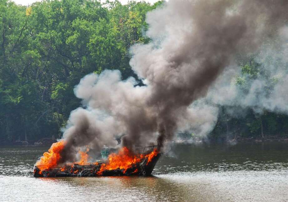 An unmanned cabin cruiser burns out of control on the Hudson River in Troy Wednesday, Aug. 4, 2010.   (John Carl D'Annibale / Times Union) Photo: John Carl D'Annibale