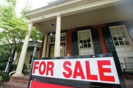 In this Aug. 16, 2019, photo a for sale signs beckon buyers to homes along Park Avenue in Richmond, Va. On Thursday, Aug. 22, Freddie Mac reports on this week's average U.S. mortgage rates. (AP Photo/Steve Helber)