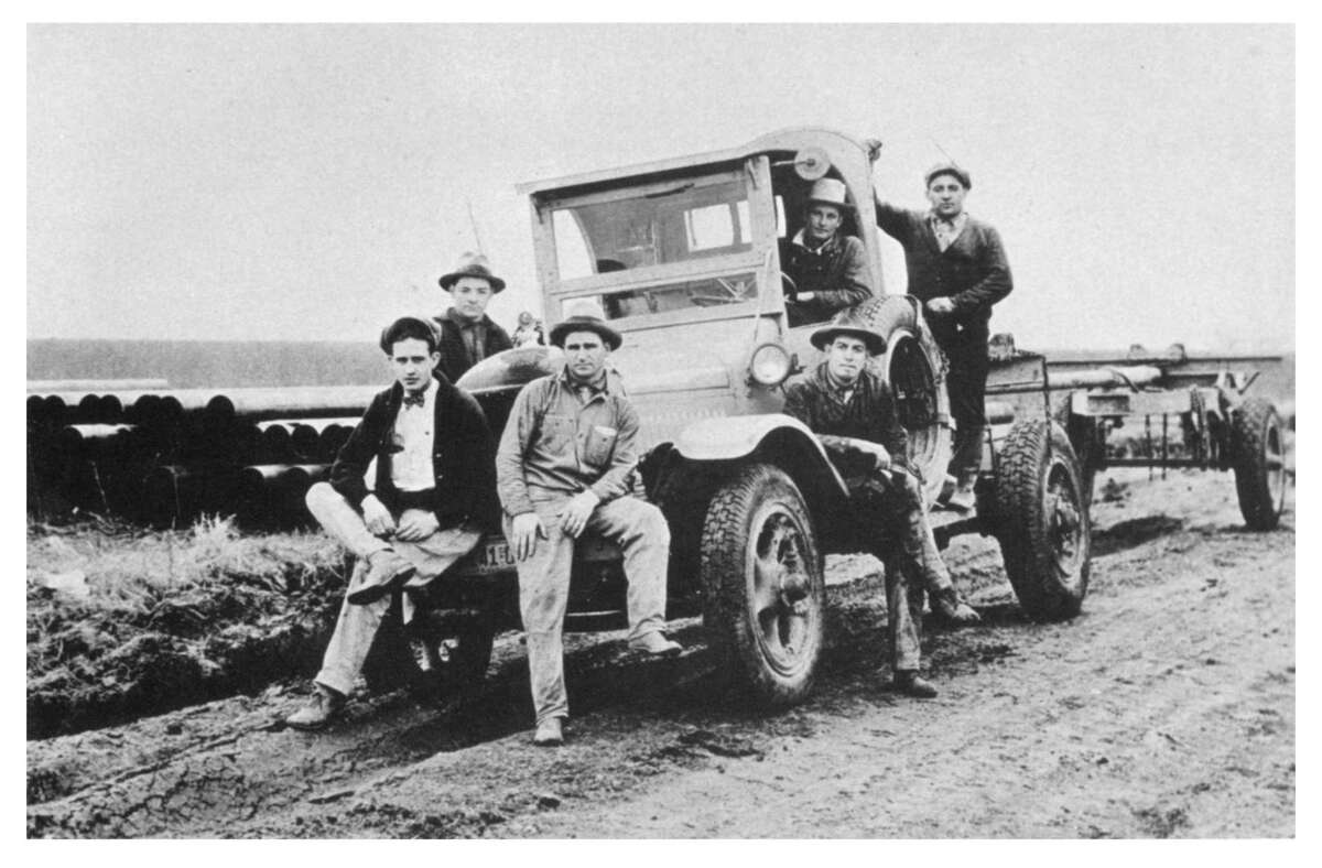 John Copeland, center on the front bumper, and a crew with the Shell Pipe Line Corp. pose on a road between Pasadena and Deer Park. Copeland began working for Shell in 1928. His family briefly lived in Tent City and then moved to a house on SecondStreet, and his daughter Elsie was in the first graduating class of Deer Park High School in 1940.