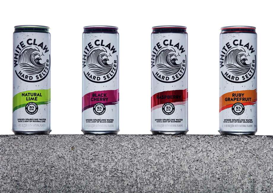 White Claw's Natural Lime, from left, Black Cherry, Raspberry and Ruby Grapefruit Photo: Russell Yip, Staff / The Chronicle / online_yes