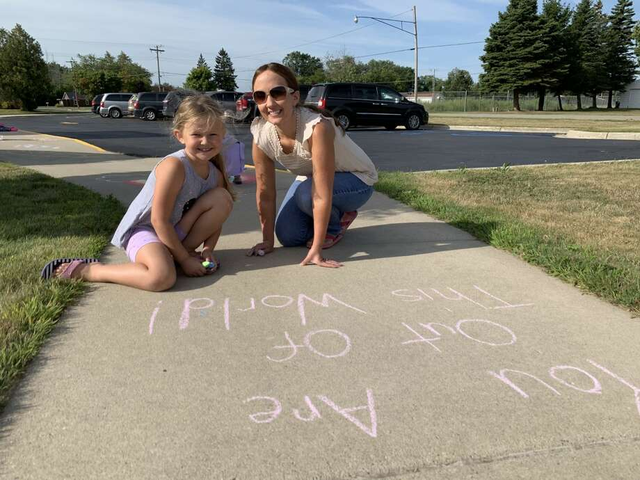 Harbor Beach Community Schools staff recently started what they hope to be an annual Chalk the Walk event. A group of teachers, and some children, spent all day Monday — the day before school started — writing positive, uplifting messages on the district's sidewalks. Photo: Courtesy Photo