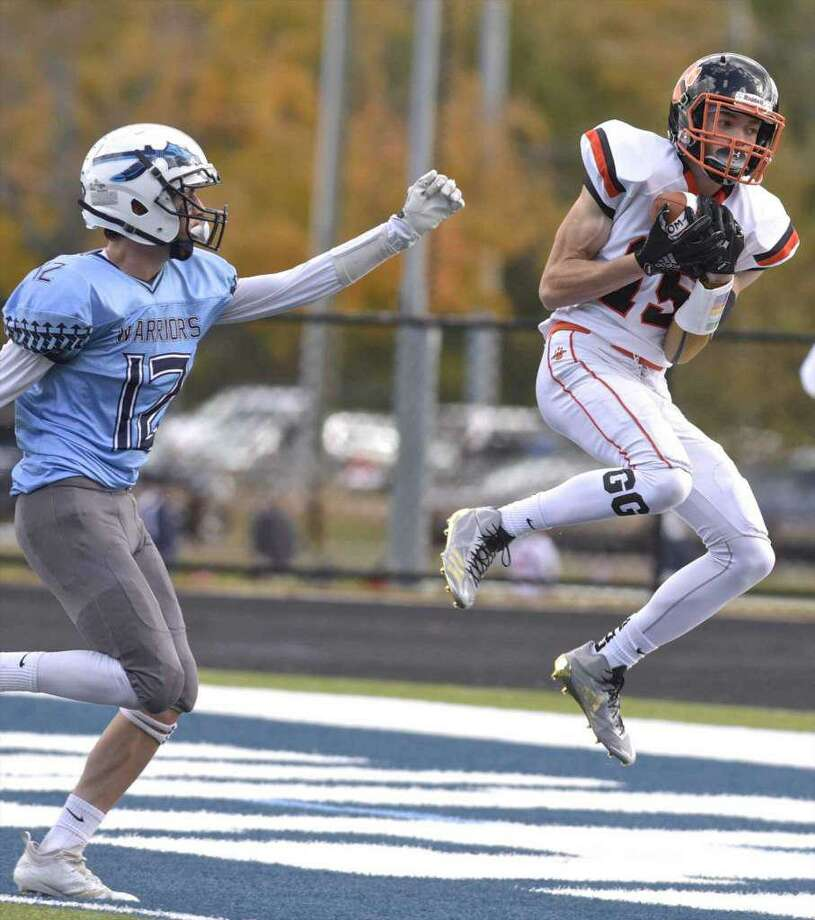 Gianni Gorham (shown catching a touchdown pass against Wilton last season) could be one of the FCIAC's top receivers this season. Photo: H. John Voorhees III / Hearst Connecticut Media