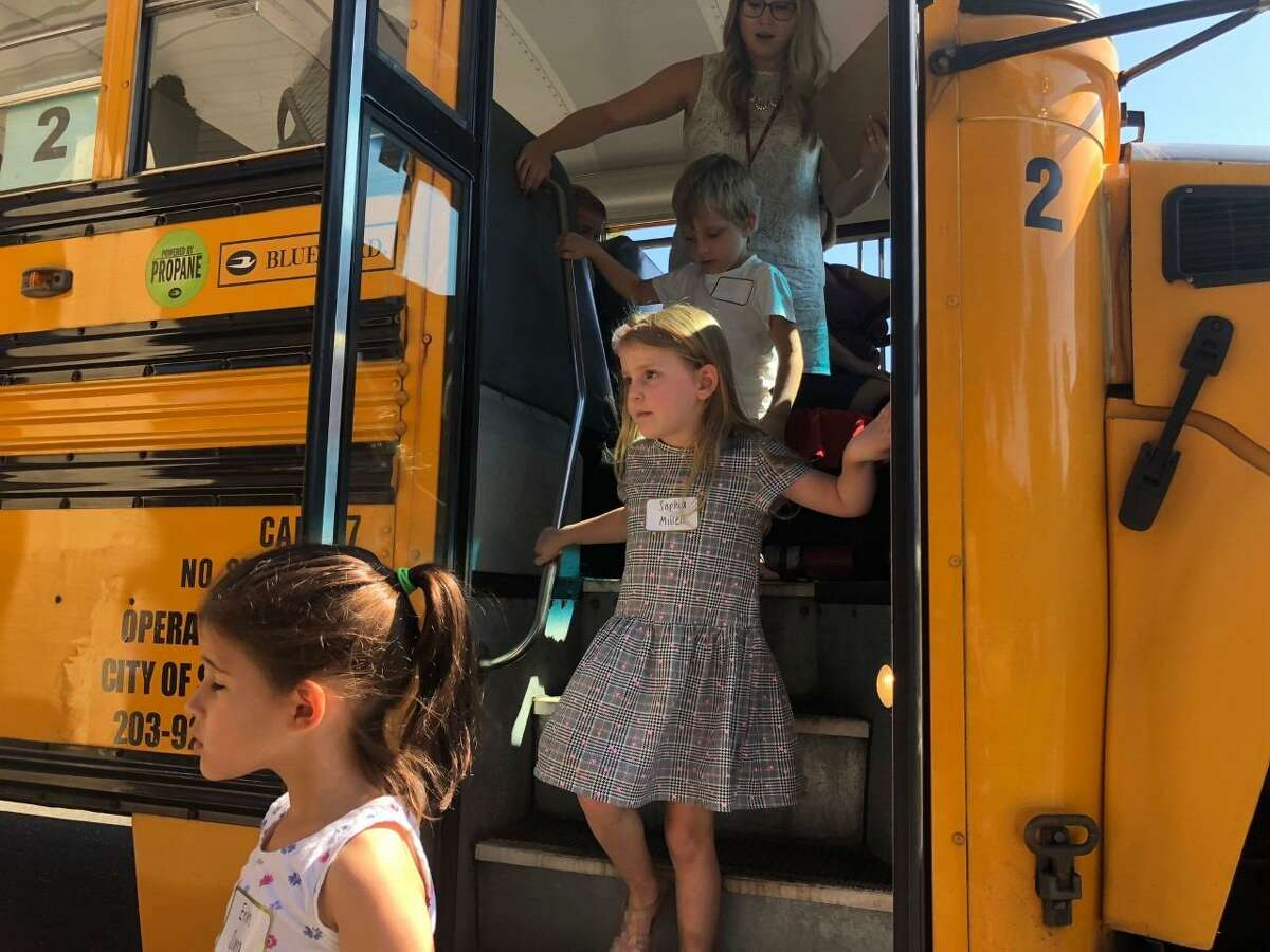 Incoming kindergartners get off the bus after going for a trial run on the morning of Friday, Aug. 30, at Elizabeth Shelton School.